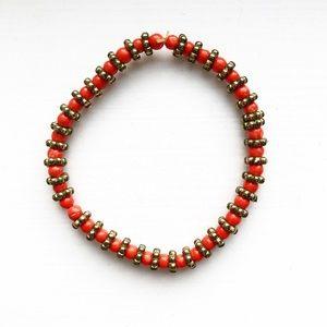 Vintage orange & brassy gold bead stretch bracelet